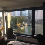 View from bedroom over the water. Boats (and crane) from maritime museum.