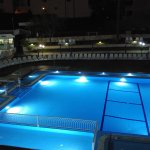 The swimming pool area is clean and inviting with a shallow area for small children.