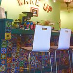Brightly colored tiles cover the counter at the North location