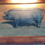 This blue pig was found during renovations and hangs over the fireplace.