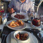 Parma ham and prawns in garlic oil
