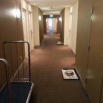 Hallway of empty room service trays