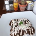 Breakfast chicken mole enchiladas.