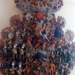 An intricate sculpture featuring numerous Dia de los Muertos figures.