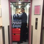 Funny pic of Hotel Staff- how many bags can you fit in the mini lift.