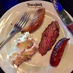 Wonderful flank steak, sausage, garlic mashed potatoes and banana.