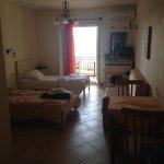 Our room - 105, ground floor. Triple bedded. Lots of room. Nice bathroom. Nice balcony. Easy acc