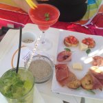 Free snacks with our cocktails, at the beach umbrellas to the right of the beach!