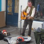 Busker and his pups on Quay Street