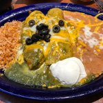 chile relleno and enchilada combination plate with green sauce