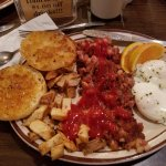 My corn beef hash and eggs. The catchup was put on by me. The grilled english muffins were excel