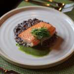 Pan seared Half Moon Bay Salmon on wild rice risotto with wild basil pesto sauce