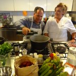 Paula showing my uncle how to make ragu.