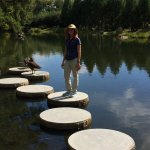 Tour guide on Japanese garden stepping stones.