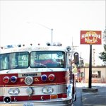 Fire truck in front of Hook and Ladder Pizza Co