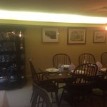 One of the larger tables in the dining area. The curio cabinet in the background is beautiful.