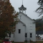 Church across from the Inn. Bell rings once at predetermined hours. Can't hear in rooms, though.