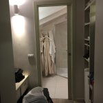 Dressing & wardrobe area leading on to bathroom.