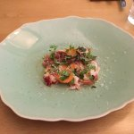 Local lobster, Serrano ham, passion fruit seeds, pickled carrots, white chocolate dust.