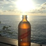 sun set view with a cold Red Stripe
