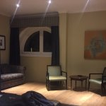 Large spacious L shaped room with spacious bathroom and shower.