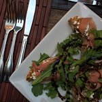 Crostini with prosciutto, fig, goat cheese and arugula - Yummy!