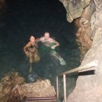 "Enjoy the ""bottomless"" mineral pool inside the Roaring River Cave"