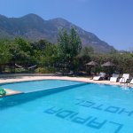 The Lapida pool and gardens with beautiful mountain backdrop