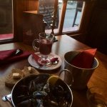 Candlelight dining by the window. Mussels (starter portion) and mulled wine!