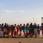 The Samburu people gathering to sing and dance for us on the river