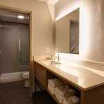 Modern guest bath with complimentary toiletries