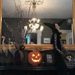 Fireplace mantle in middle room decorated for Halloween