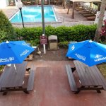 Picnic tables in pool area.