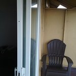 No screen door on the slider and only one chair.