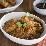 Beef Rendang - Slow cooked beef cubes in an aromatic curry paste mixed with coconut milk.
