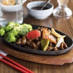 Mongolian Beef - Sliced beef, stir-fried with vegetables in a savoury brown sauce.