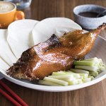Peaking Duck – Roast duck eaten with spring onion, cucumber and sauce with pancakes rolled aroun