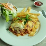 Lasagna with salad an chips