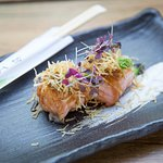 Seared salmon sushi ball with jalapeno sauce