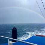 A rainbow viewed from the back of the Ship