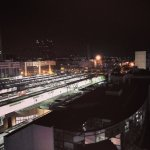 Executive suite overlooking the train station (night)