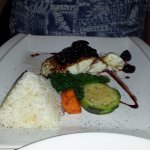 His meal- Halibut with veggies & rice.