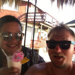 Enjoying delicious pina colada and relaxing in the swing chairs at Foster's