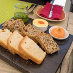 Beautiful bread platter with mouthwatering condiments.