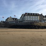 view of Hotel de la Marine from the beach