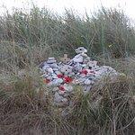 An impromptu shrine in the beach grass outside the Juno Beach Centre.