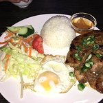Grilled Pork chop with fried egg n Rice. Salad lacks, the pork chop is very good tho it makes up