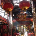 Prayer hall flanked by large red lanterns in Sin Sze Si Ya Temple