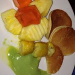 Pineapple, jelly and fried bananas with green coconut custard and pancakes