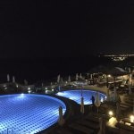 Pools by the Athena at night. leads to pool bar, more sunbeds, hot tubs and another pool bar!